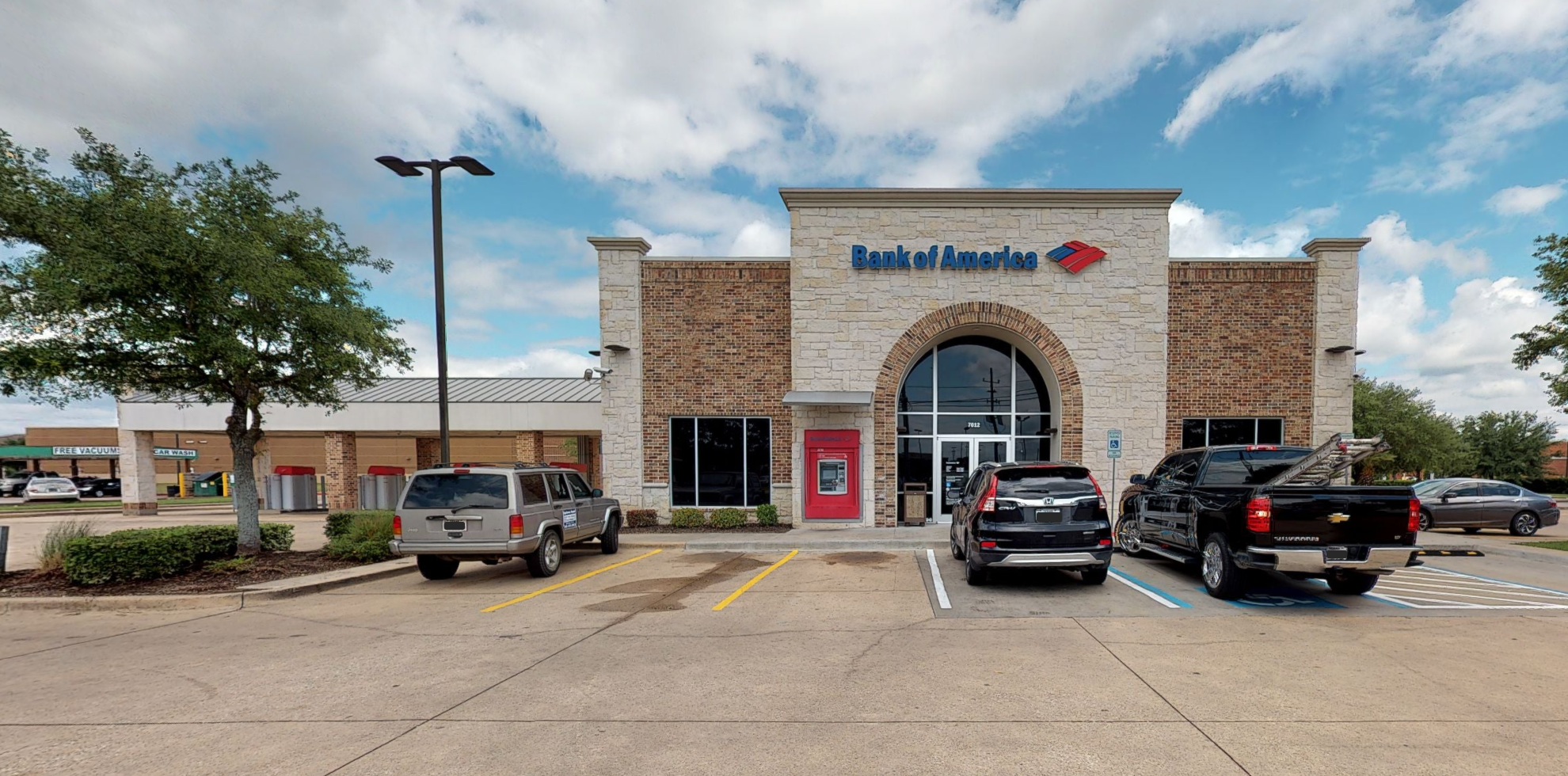 Bank of America financial center with drive-thru ATM   7012 Barker Cypress Rd, Cypress, TX 77433