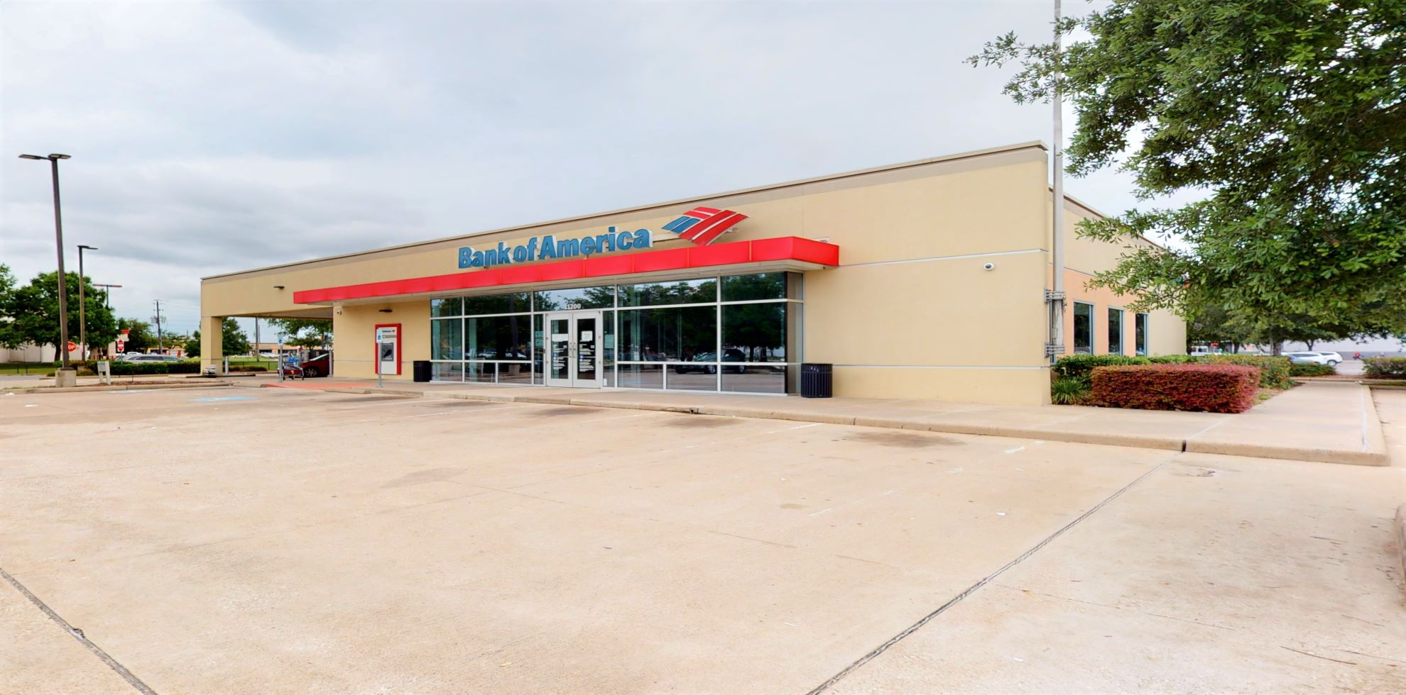 Bank of America financial center with drive-thru ATM and teller   11200 S Gessner Rd, Houston, TX 77071