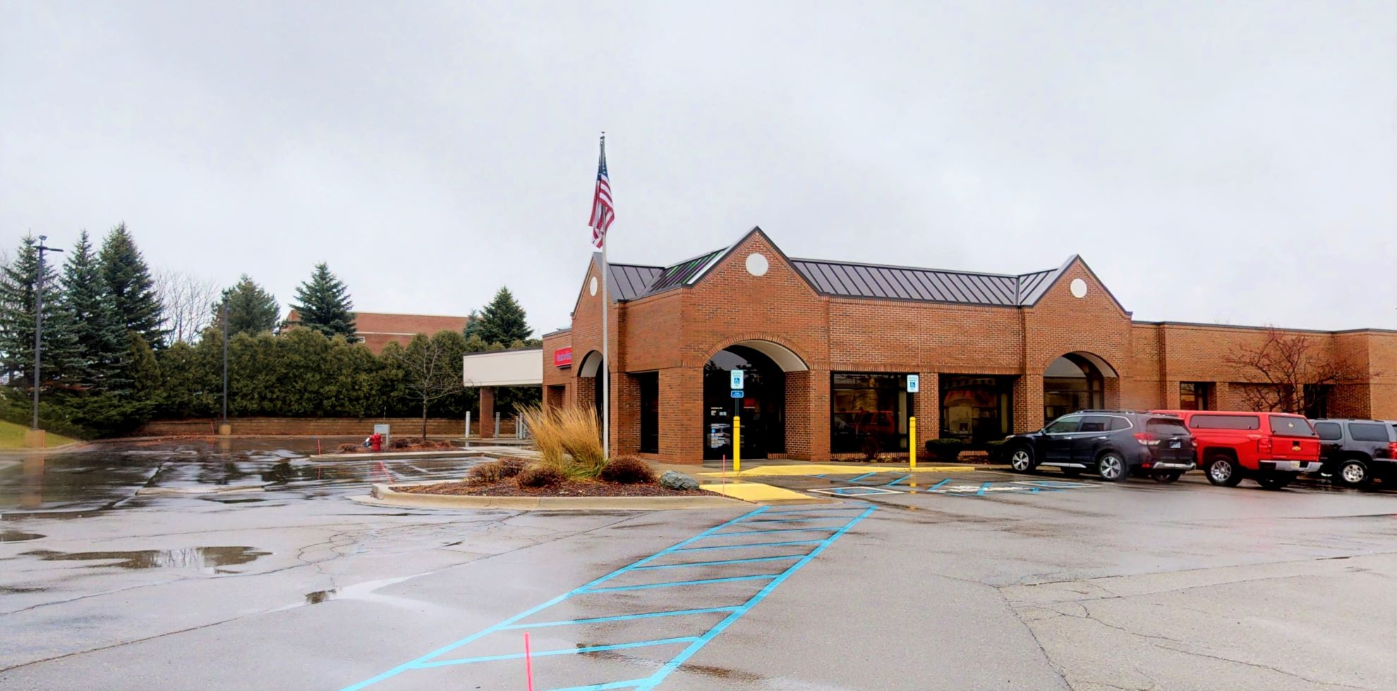 Bank of America financial center with drive-thru ATM   3400 E Grand River Ave, Howell, MI 48843