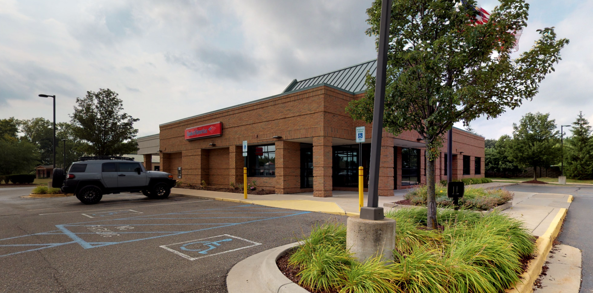 Bank of America financial center with drive-thru ATM   16124 West Rd, Woodhaven, MI 48183