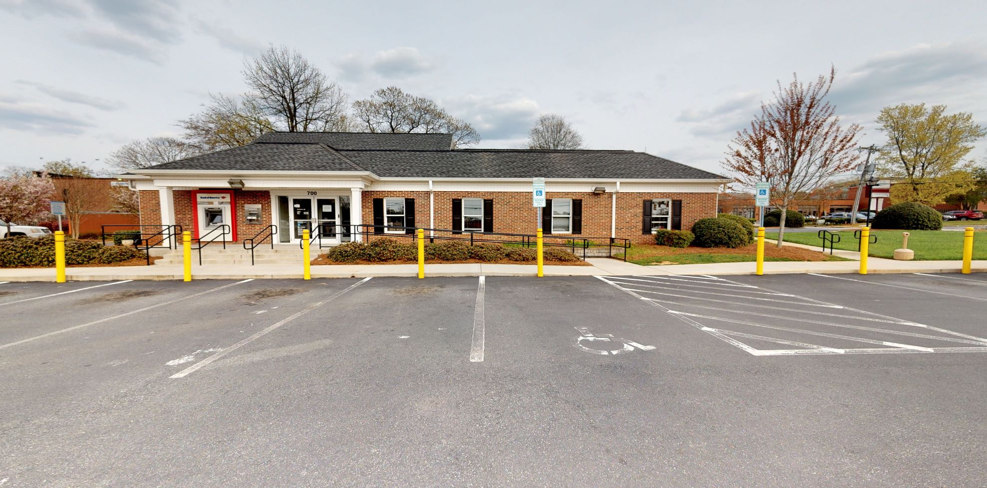 Bank of America financial center with drive-thru ATM   700 College Rd, Greensboro, NC 27410